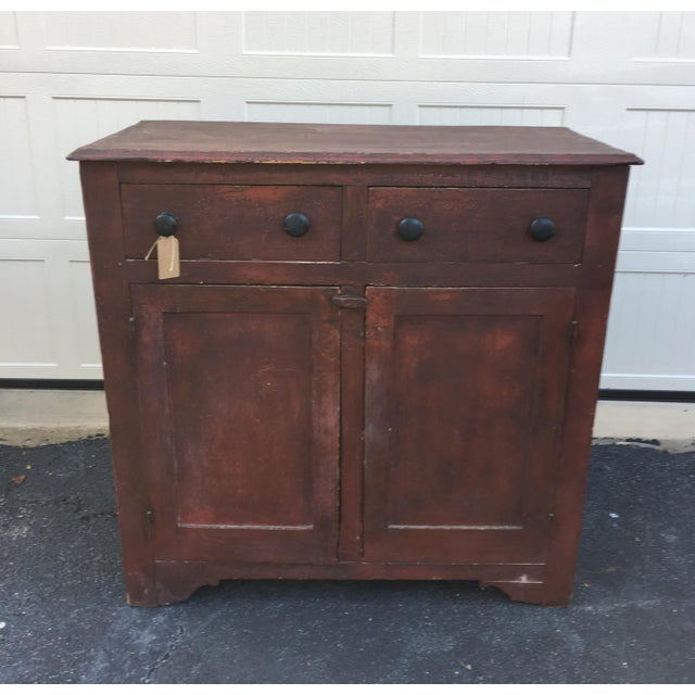 Charming antique 19th century jelly cabinet for sale. It is painted a beautiful brick red, which is either original or...