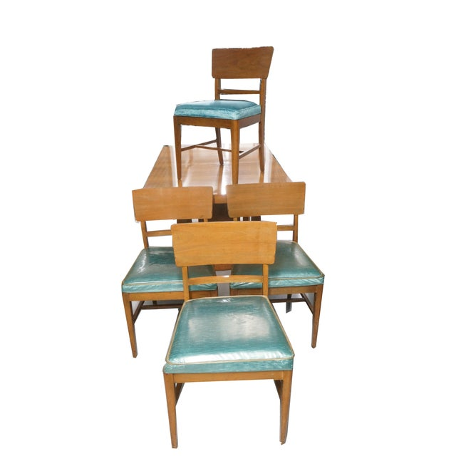 Mid century modern dining table with 4 upholstered chairs. Made by Morris of California and part pof the Architectural...