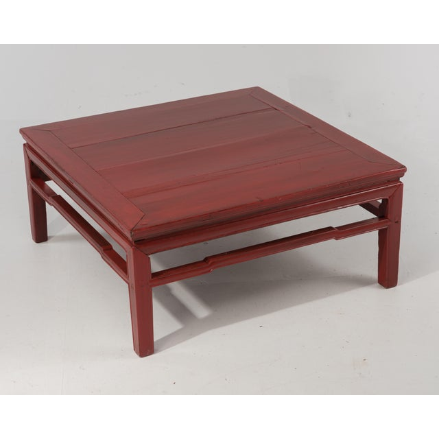 An early 20th Century Chinese red coffee table. We regularly arrange delivery further than 40 miles, please ask us to...