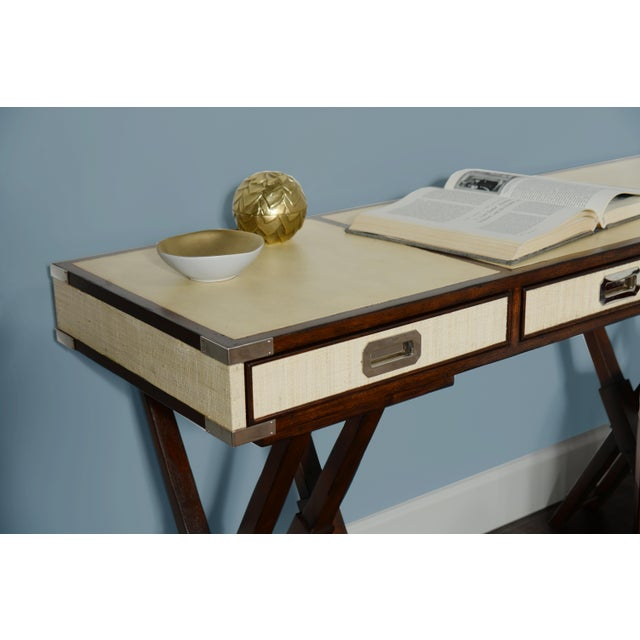 This David Francis desk features a mahogany frame and faux finished top. The drawers are raffia wrapped with chrome...