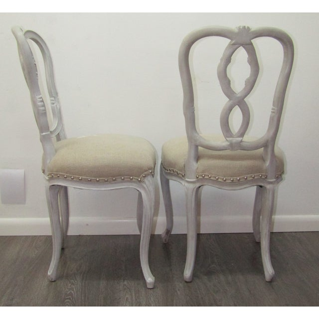 Unique Pair of Vintage Chairs. This pair feature a wood frame with figure eight backs. The wooden frames are pale grayish...