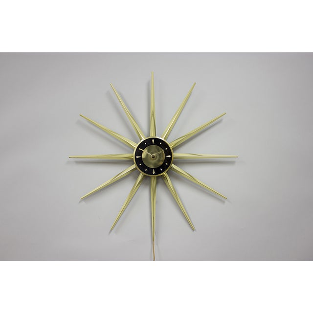 "Mastercrafters starburst ""Master Star"" clock. Beautiful example comprised of brass spires with black and brass face...."