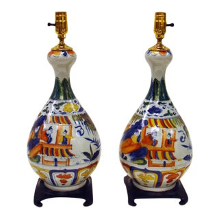 Chinese Porcelain Bottle Shape Lamps With Mongolian Motif & Rosewood Base - a Pair For Sale