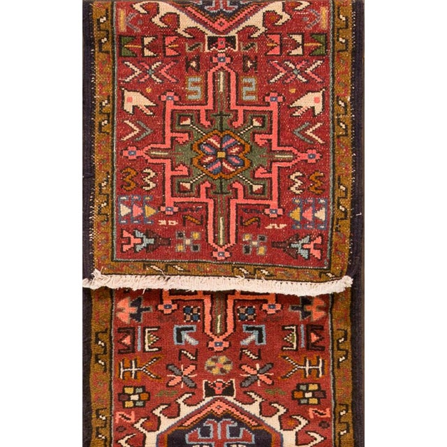 Vintage hand-knotted Persian Heriz rug with a geometric motif. This piece has great detailing and great colors. It would...