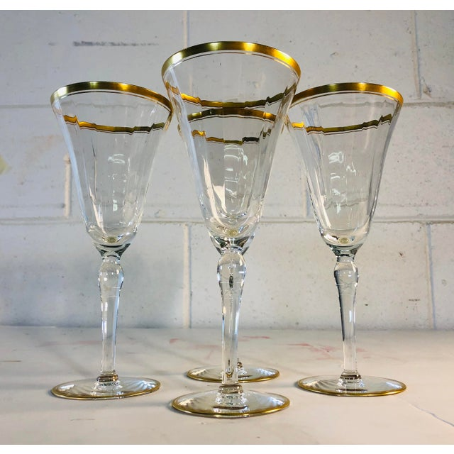 Hollywood Regency style double gold rim tall champagne or wine stems, set of 4. Excellent condition. No marks.