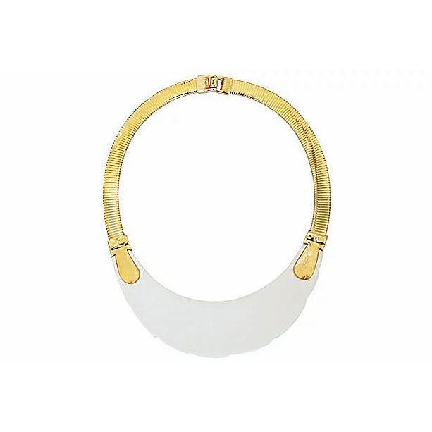 "1980s goldtone and molded white Lucite collar necklace with fold-over clasp. Marked ""Napier."" Overall measures: 7 inches L..."