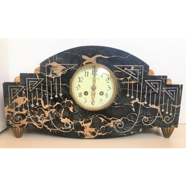 About Art Deco clock with ornamentals carved motifs and bronze legs. Measurements: Clock H 9.25in, D 4in, W 16.9in...