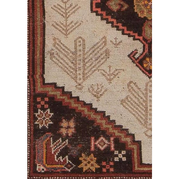 This is an early 20th century camel hair style rug from the greater Hamadan weaving area. Instead of camel tone field, it...