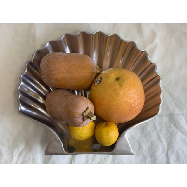 This shiny molded shell dish is fabulous for holding remotes, keys, fruit, jewelry, whatever your heart desires. It has...