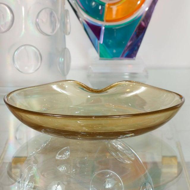 Organic form gold flecked Murano glass bowl.