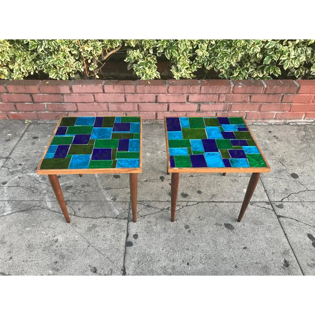 Stunning pair of matched mosaic glass tables by Georges Briard. These are made in the 60's with pieces of cut glass in...