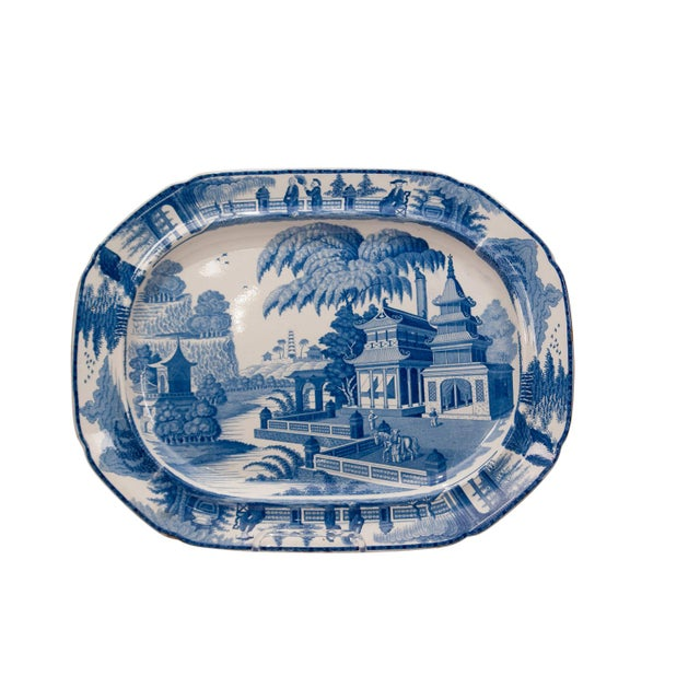 An early 19th Century English large blue and white platter in the Chinese style, circa 1820