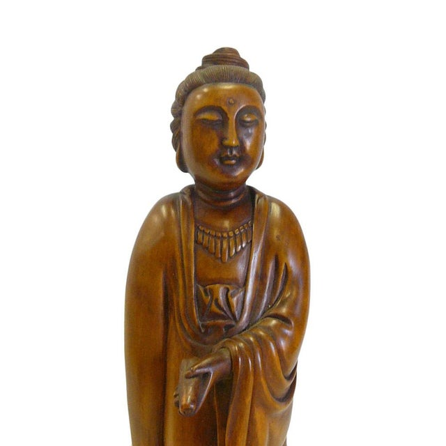 This is a decorative hand carved oriental Chinese standing Kwan Yin statue. She has nice elegant posture and details....