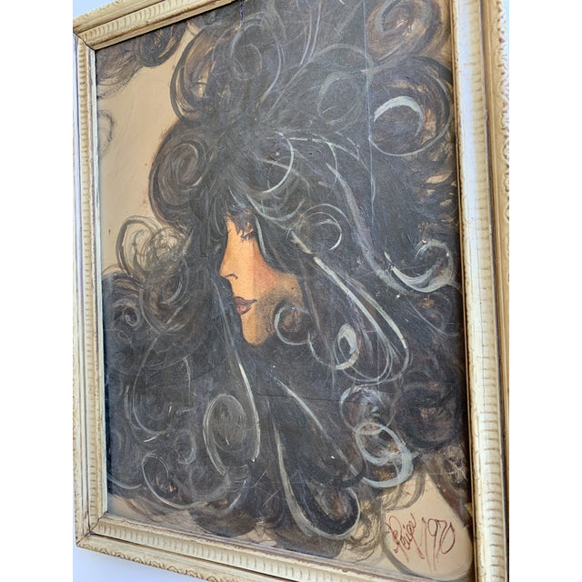 Framed mixed media print of a woman on hardboard. This item features printed images and various different pieces of paper...