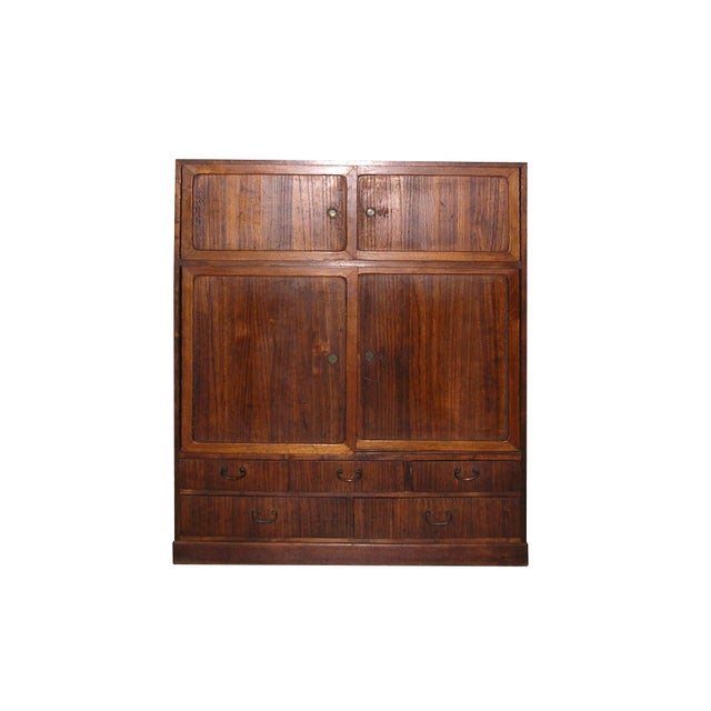 Up for sale is an elegant small antique Japanese Tansu cabinet with well-arranged drawers and sliding doors, overall...