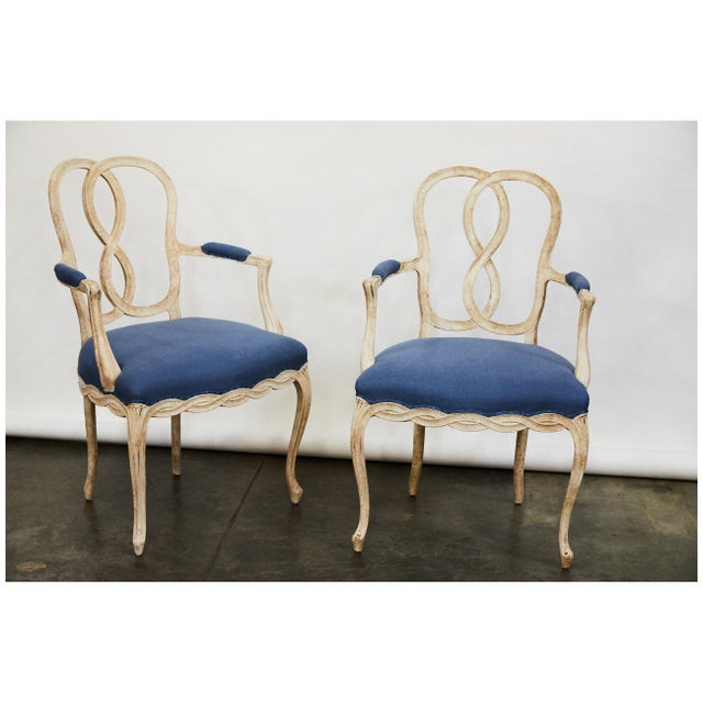 This pair of bergere chairs have been upholstered with blue Irish linen fabric. They have a nice simple open carved base...