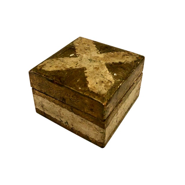 A small turn of the century Italian Florentine box with an X design on top.