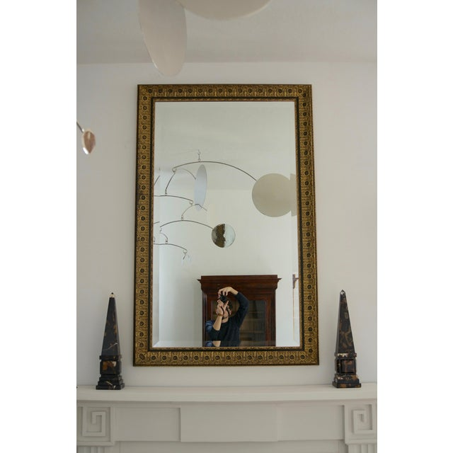 This stylish and chic neoclassical wall mirror was acquired from a Palm Beach estate and was from a design project by Juan...