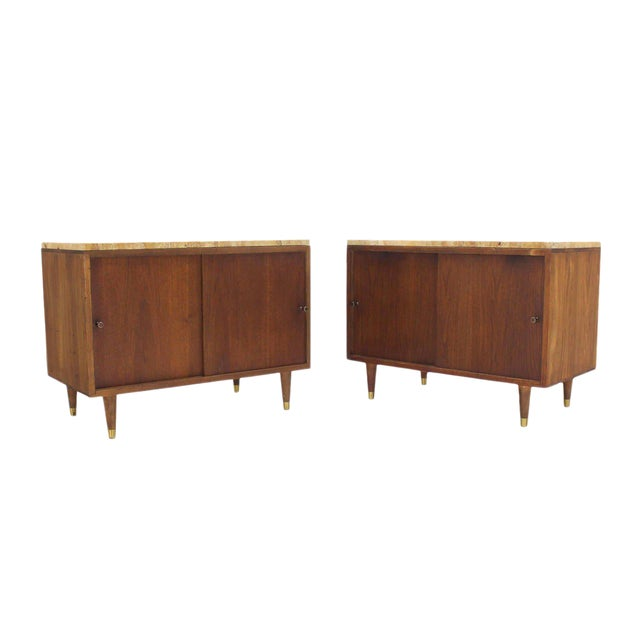 Pair of Marble or Travertine Top Walnut Cabinets with Sliding Doors For Sale