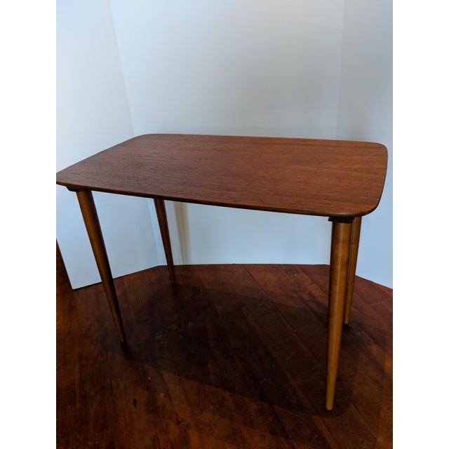 Set of mid century 3 solid teak nesting tables marked Norway on the underside of each.