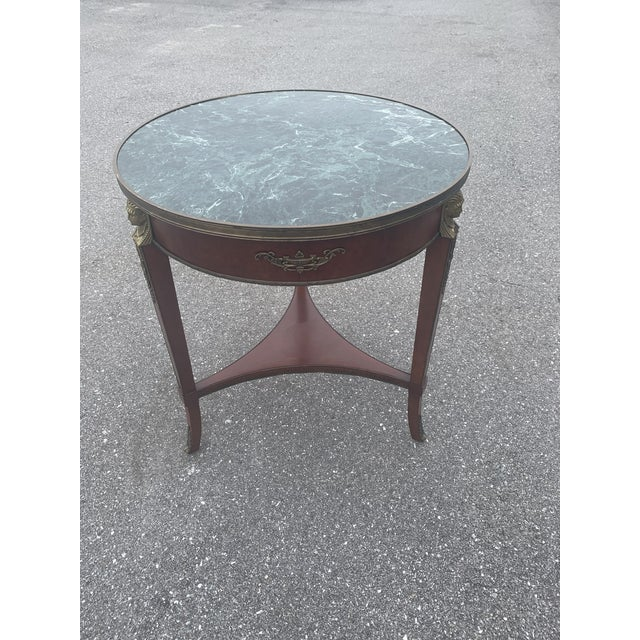 Vintage John Widdicomb wood table with green marble top. Excellent overall vintage condition.
