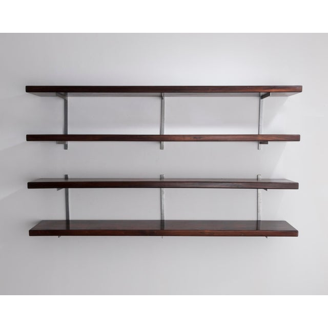 Wall-mounted shelves in wood. Designed by Sergio Rodrigues, Brazil, 1960s.