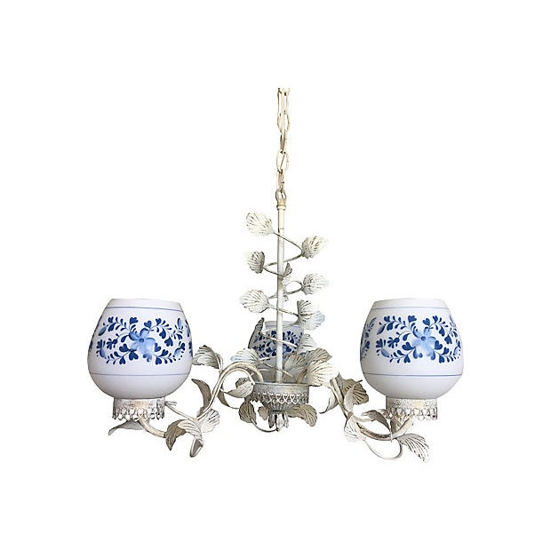 Light and airy midcentury floral chandelier by Halcolite featuring a metal frame of twining leaves, cutout hearts and...