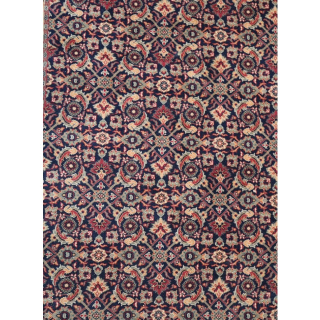 """Karastan Rug in Feraghan Pattern and Navy Color. The rug is 5'5"""" wide and 8'6"""" long."""