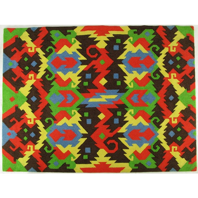 Chocolate brown, saffron yellow, sky blue, grass green, and Chinese red, combined in a Mayan-inspired abstract pattern,...