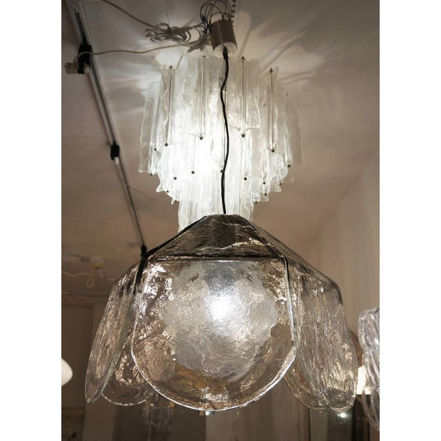 Large Carlo Nason for Mazzega pendant/chandelier. A light metal structure holds six large glass petals darker on top and...