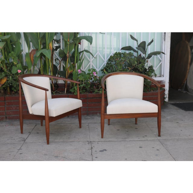 Just reupholstered Kodawood Sculptural Pair of lounge chairs. Has no damages on wood. Very comfortable and strong.
