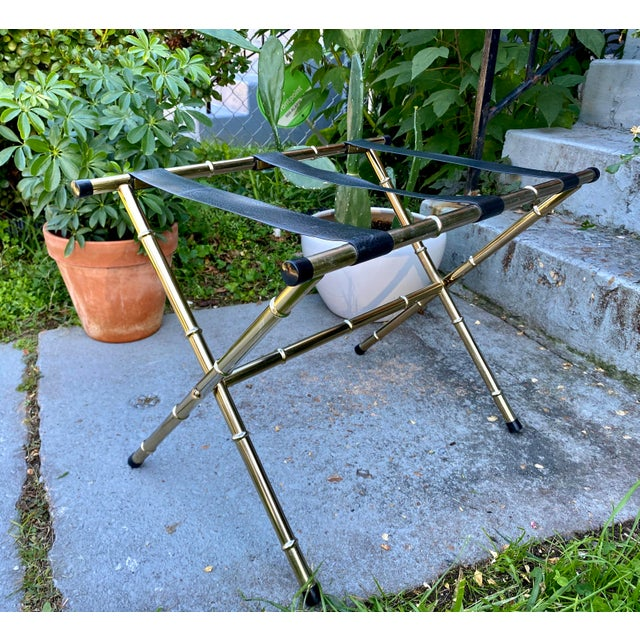 This excellent brass luggage rack is beautiful faux bamboo and has faux leather straps across the top. The straps are a...