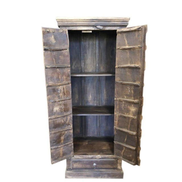 The armoire comes from India and is an original antique 19c piece A true rustic antique Armoire from a village just...