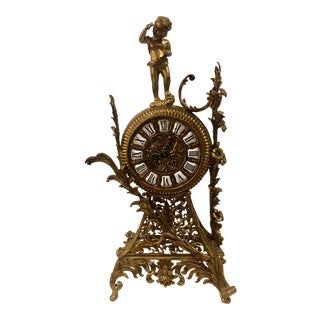 1950s Brass French Mantel Clock With Cherub Holding Chisel and Hammer With Floral Designs For Sale