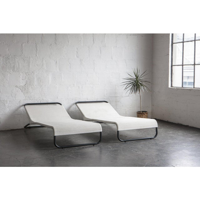 Accenting the rise in bent-tubular furniture of the mid-century period, these chaise lounges beg you to relax in the sun....