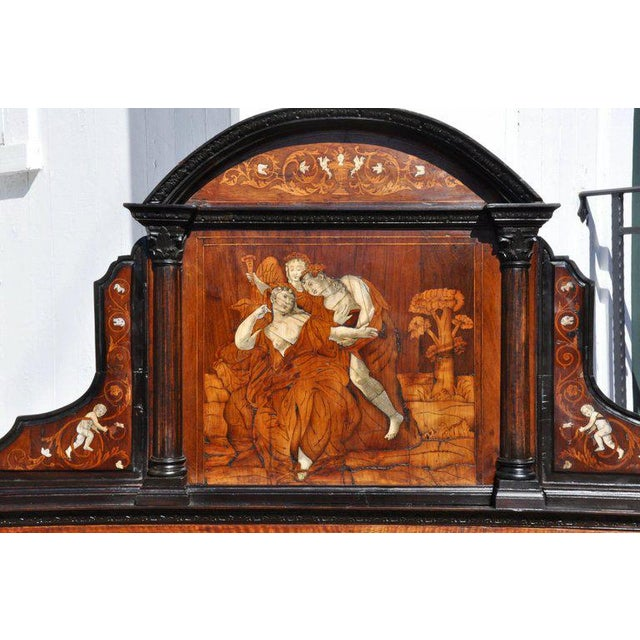 Period 18th century neoclassical Renaissance style walnut and bone inlaid bed. This bed retains its original inlays and...