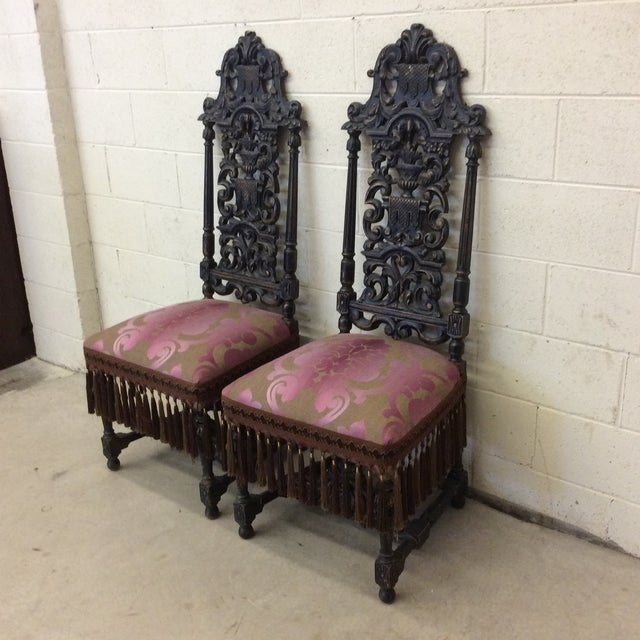 Amazing juxtaposition of the heavy carved wood and modern feel of the pink damask upholstery. Pink and brownish tan fabric...