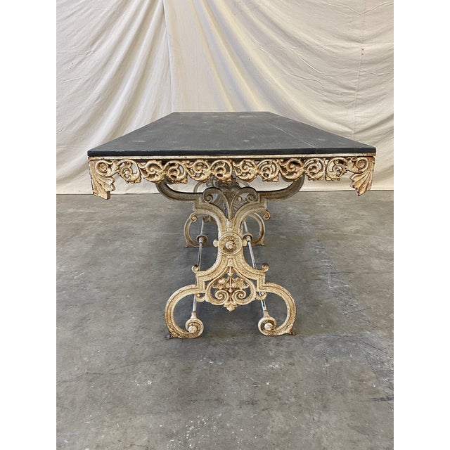 Fantastic French pastry table, with ornate three station iron base, and vintage painted wood top. This super stylish piece...