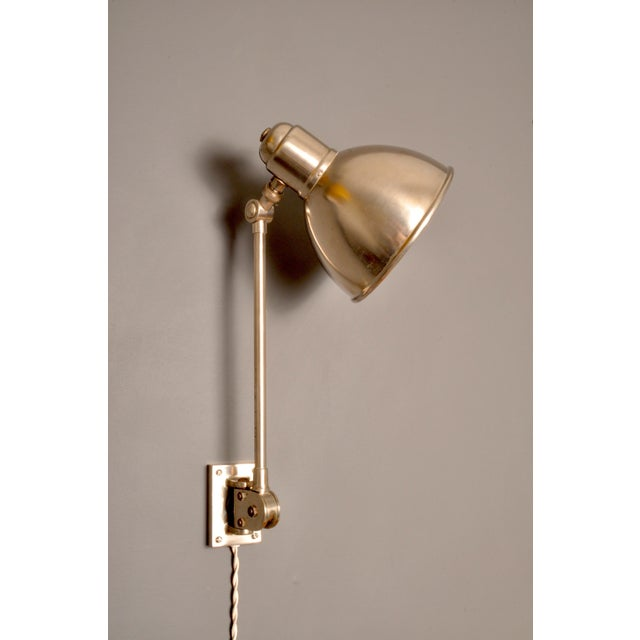 Wall mount nickeled brass multi adjustable architect's lamp designed and manufactured by lighting design firm BAG TURGI,...