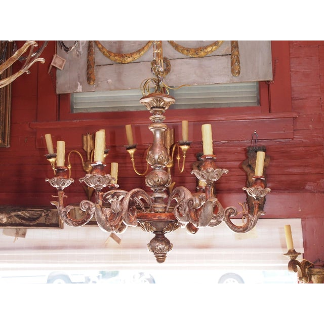 Italian Rococo revival carved and painted 6 light wood chandelier. Painted acanthus leaf motif, silver and gilt accents....