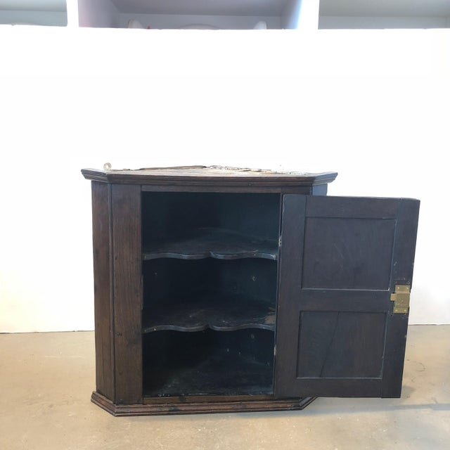 This listing is for an 18th Century English Oak Corner Cabinet. It is in very good condition.