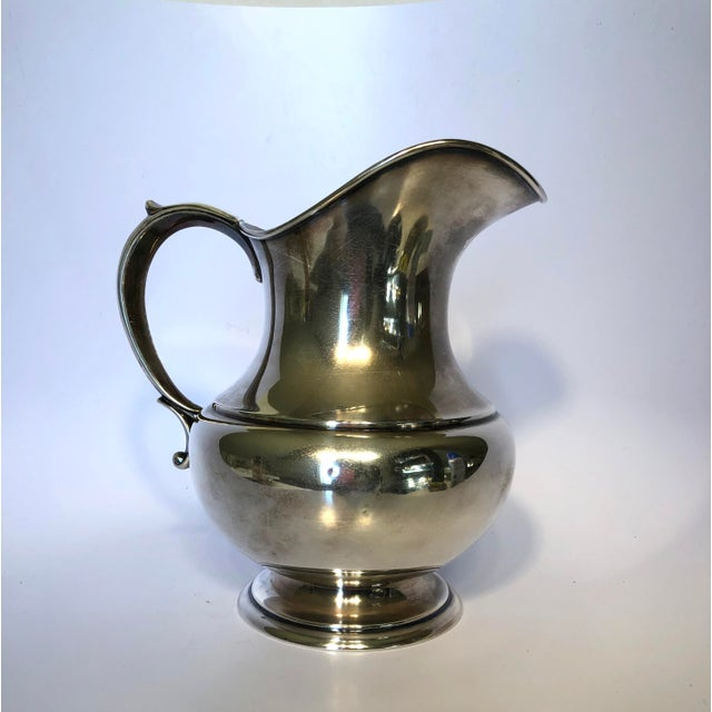 A vintage sterling silver pitcher made by Reed & Barton. This pitcher is from The Pilgrim collection circa 1956. Features...
