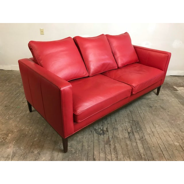 Hot red leather sofa by McCreary Modern for Room & Board. In very good condition, two small scuffs as shown. It measures...