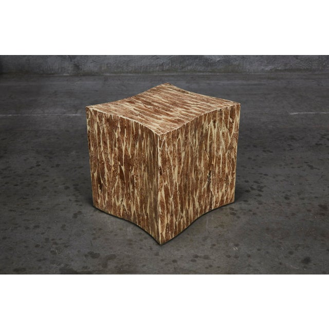 Contemporary freeform side table hand-inlaid with cotton husk inlay over a cream lacquer finish applied to a fiberglass...