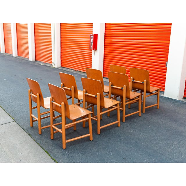 Set of 8 Beechwood dowle frame with oak bent plywood seats combines to create an architecturally unique chair very similar...