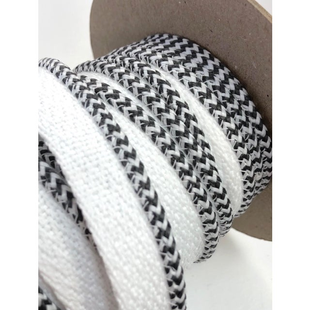 """One, 10.5 yard spool of 1/8"""" Indoor/Outdoor braided cord with flange. Color: Charcoal/White Flange is 1/2"""" wide for sewing..."""
