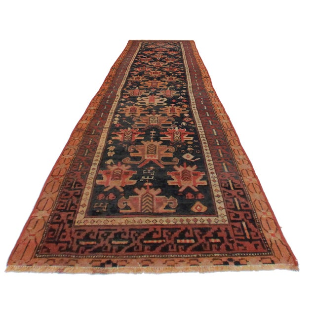Offered is an antique wool Russian Caucasian runner rug. This hand knotted rug features an all over design with tones of...