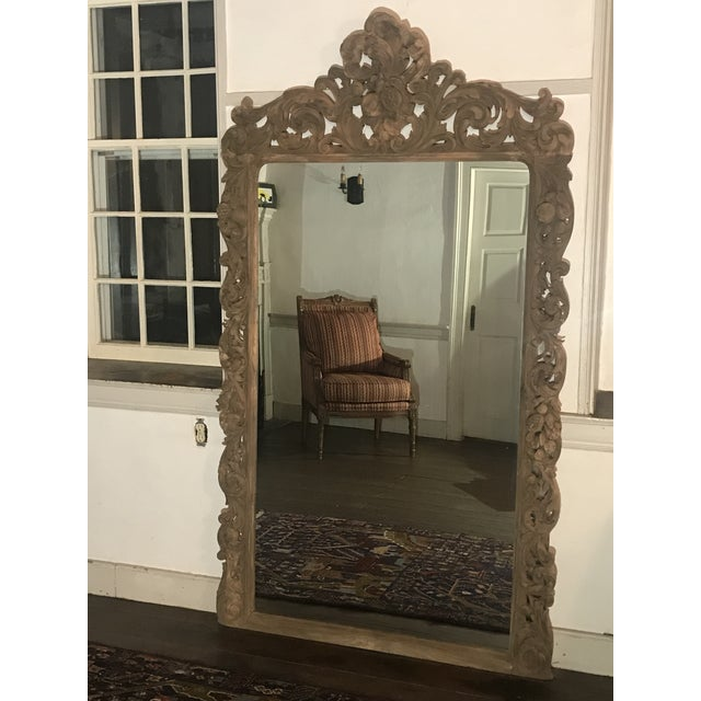 Hand carved wood, floor length mirror by Zentique adds charm and elegance to a room.