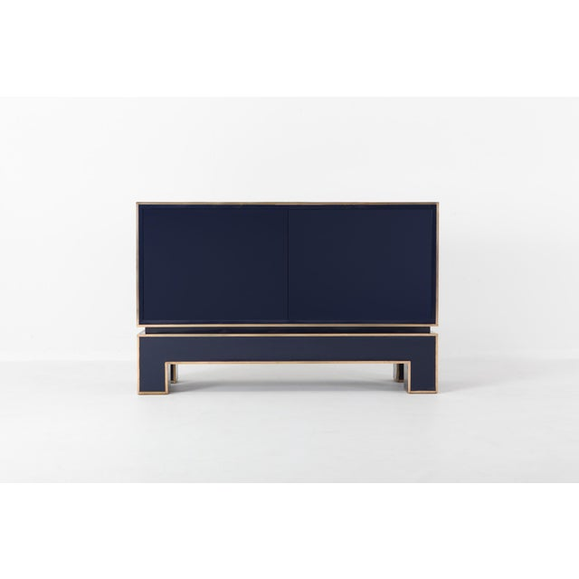 Blue and brass two-door cabinet in Hollywood Regency Italian glam style this high end cabinet is finished front to back...