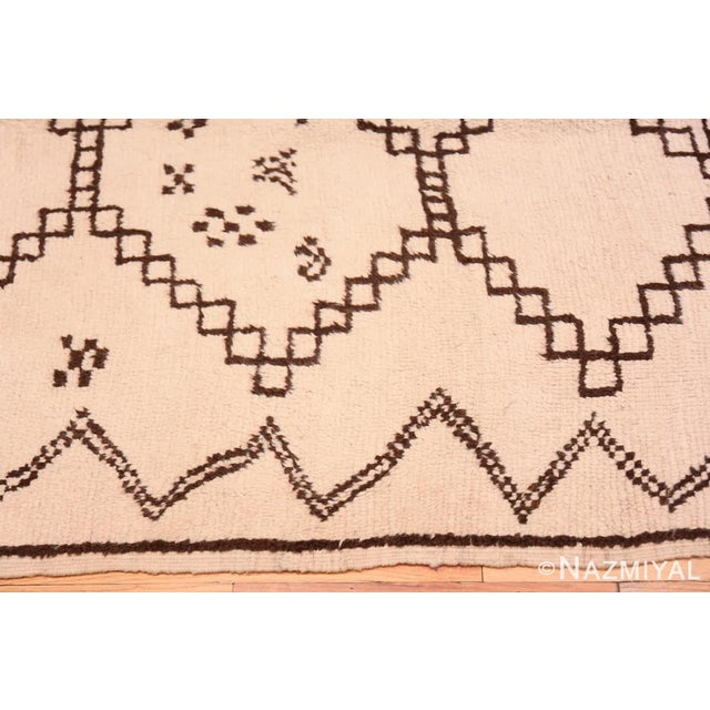Vintage Ivory and Brown Moroccan Rug, Origin: Morocco, Circa: Mid-20th Century – Here is a unique and thought-provoking...